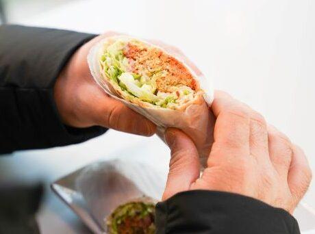 Customer enjoying Pita Wrap